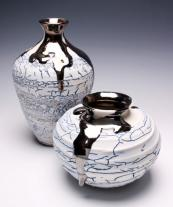 Alex McCarthy ceramics are textured to resemble cracked earth or paint. www.mccarthyceramics.com
