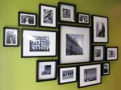 An easy solution to keeping your walls interesting is to have your photos in black frames. Build up a collection and group them together