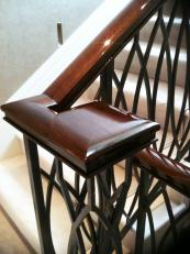 Solid wood handrails can look exquisite after French polishing