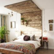 The Heaths' master bedroom has a headboard made from recycled wood