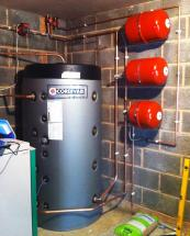Tank to store hot water heated via a biomass boiler