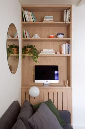 Built-in Oak bookcase at one end of the room gives more useful storage