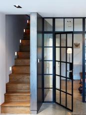 The Crittall black steel framed doors and windows are back in vogue - use with clear glass indoors. This scheme by London interior designers Frank & Faber