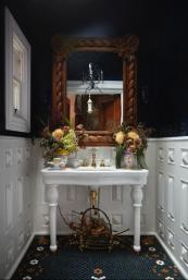 A downstairs washroom with a salvaged ceramic washstand