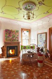 Vivian's daughter's bedroom has a stencilled floor and a lime green ceiling