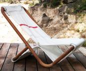 Lounger chair on wooden frame by Dvelas. POA