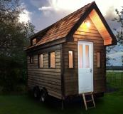 A Tiny House by Mark Burton of Tiny House UK. It's portable and can be used off-grid. Price around £25,000. www.tinyhouseuk.co.uk. DIY garden kits available, around £7,000