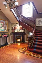 The grand entrance hall and staircase - the house is full of reclaimed timber
