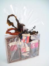 Cellophane wrap tied with a seaweed bow makes this hamper look delightful