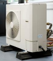 An air source heat pump is fitted onto an outside wall