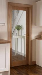 Glass in a wood frame makes for a door that's there and not there. Door by www.howdens.com