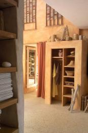The house has plenty of storage, such as this plastered unit