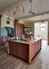 The colourful painted kitchen has a large island unit