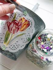 Apply your motif and then decorate around the edge of the doily with flat beads - position them using tweezers