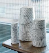 Porcelain vessels by ceramicist Myer Halliday with hand drawn decorative design