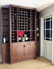 A bespoke American black walnut wine cabinet for a client