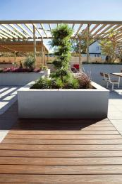 Decking works well when mixed with other outdoor materials, e.g. stone, and grass