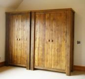 Wardrobes with a  wax finish that brings out the warmth of the wood