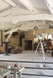 The owners' workshop is white and full of fascinating objets