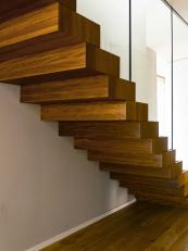 The staircase to the first floor is clad in FSC iroko wood