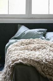 Garter stitch felted merino wool bedspread by Jacqueline Fink