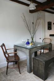 Glass topped table by Antiques by Design is made from a 1920s' galvanised water tank. £1,395