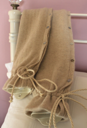 YuYu, natural rubber hot water bottle with its own cashmere cardi. From £69. www.yuyubottle.com