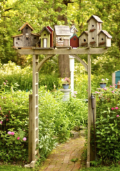 Make your own birdhouse arbour in your garden ..a great DIY project. Find simple birdhouses at B&Q or Homebase and group them together on a platform