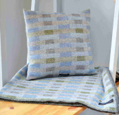 Wool cushion and throw by textile maker Madeleine Jude. Handmade Edinburgh