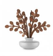 Alessi's Brrr diffuser with ceramic pot and mahogany leaves, £59. Subtle bergamot scent. www.alessi.com