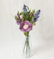 Hand-made paper flowers made to fair trade standards in Thailand from Posy & Pot. Ranunculus and lavender posy £79. www.posyandpot.com