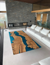 A huge bespoke coffee table with blue 'rivers' running through it