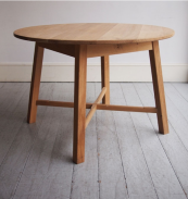Oval Cross-Stretch English quarter-sawn oak table from HOWE® based on an 1890 design by Sir Ambrose Heal.