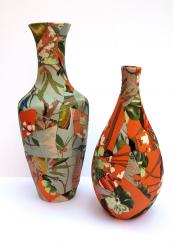 Broken ceramic vases recovered with textiles and stitched together by Zoe Hillyard