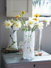 Paper doilies are perfect for transforming a boring glass column into a lovely vase