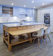 Island unit with a breakfast bar from Woodstock Furniture, which usesFSC certified timber and heats its premises with briquettes made from its sawdust and waste wood. Kitchens from £30,000. www.woodstockfurniture.co.uk