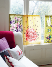 Tea towels are great for covering the lower half of windows if you  don't want to be overlooked