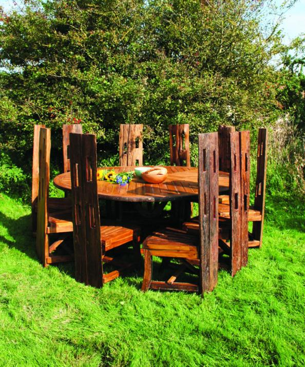 Authur table top made from a recycled cart wheel, chairs from reclaimed  fence posts.