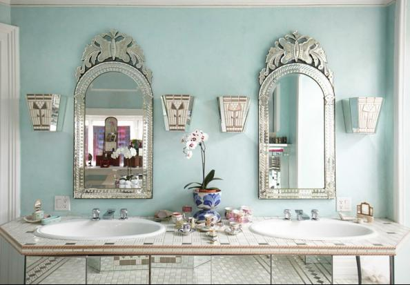 A master bathroom featuring antique French mirrors
