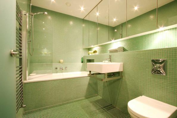 This bathroom has Bisazza glass mosaic tiles in three shades of green
