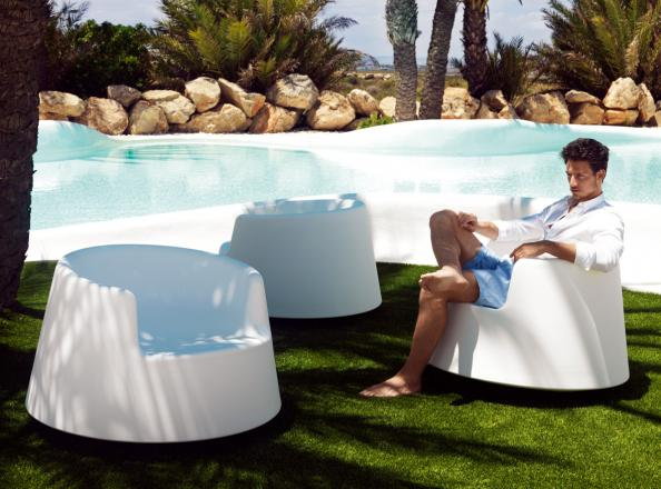 Vondom's Roulette chairs by Eero Aarnio swivel on their bases. Made in  Spain from fully - Eco-friendly Garden Furniture: Relax In Your Own Great Outdoors