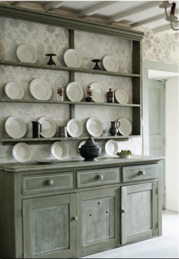 A Painted Dresser In A Washed Out Green